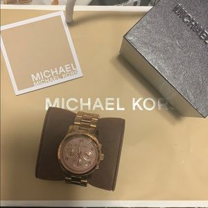 Michael Kora rose gold women's watch lightly used